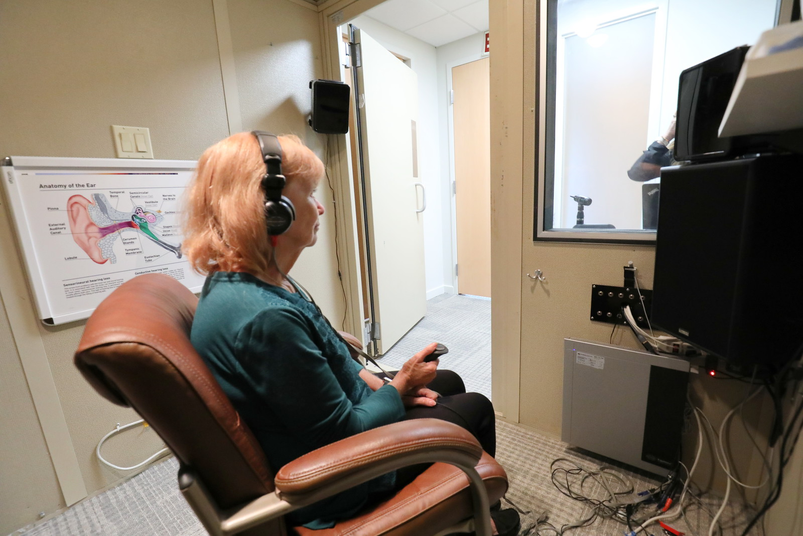 Patient getting hearing test at Cortland Hearing Aids