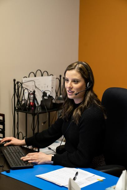Kati, our apprentice, testing a patient's hearing.