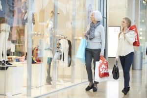 two women shopping together in mall