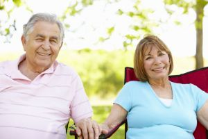 Mature happy couple relaxing outdoors