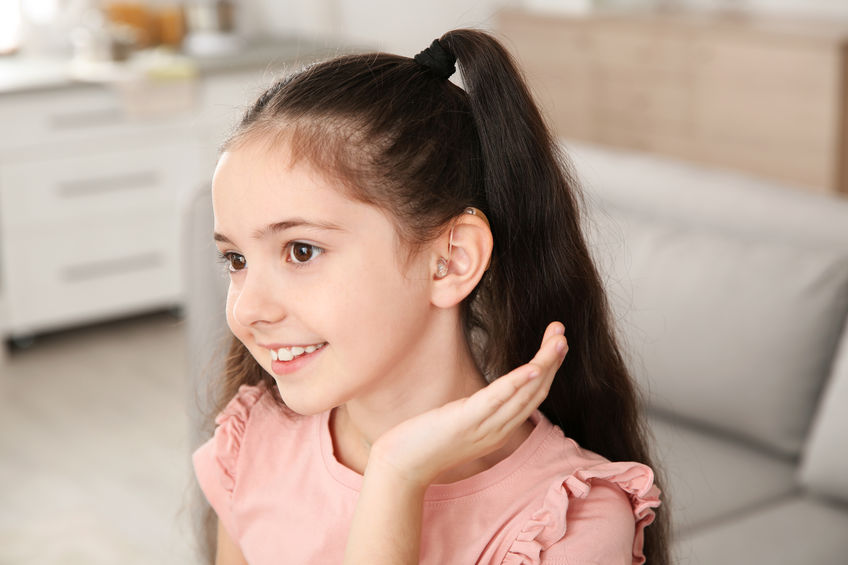 A girl with a hearing aid.