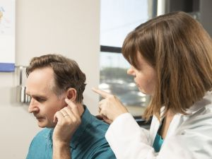 A man gets a hearing exam.