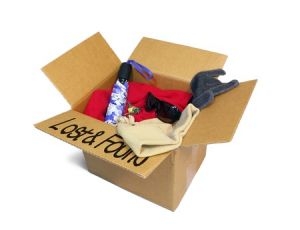 "box of items labeled ""lost and found"""