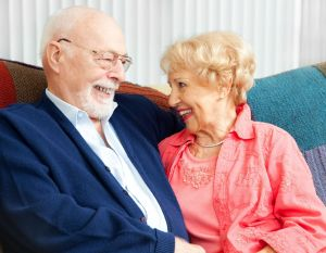 Older couple with hearing aids.