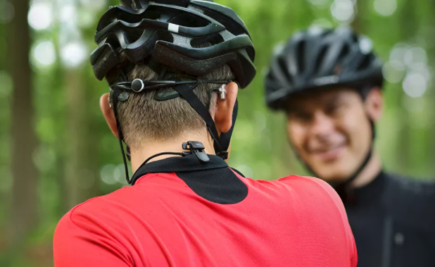 A bicyclist wears an Oticon SmartClip to protect his hearing aid.