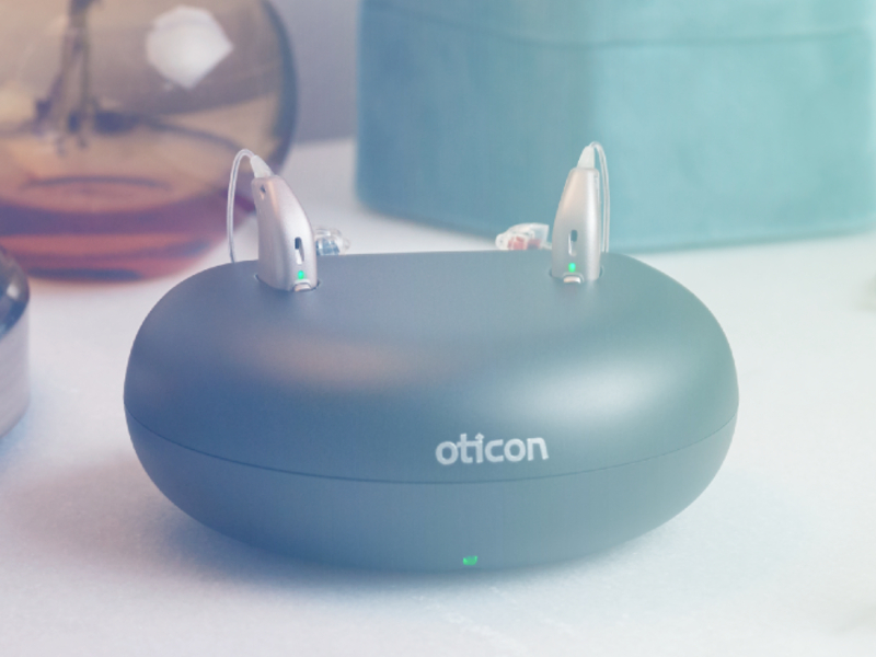 Rechargeable hearing aids on a charging dock