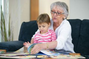 Grandmother reading to young girl