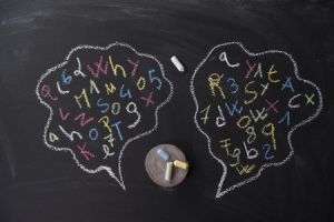 blackboard with jumbled syllables of speech