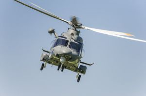 military helicopter in clear blue sky