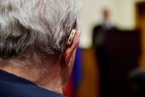 back of man's head showing BTE hearing aid