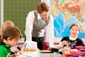 Teacher and children in a classroom setting