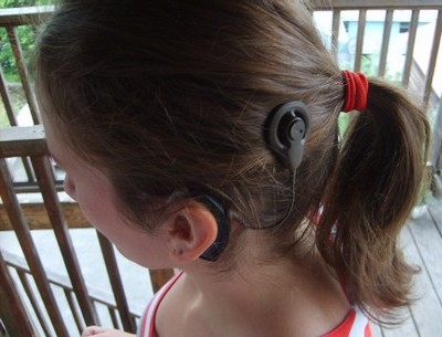A child wearing a cochlear implant