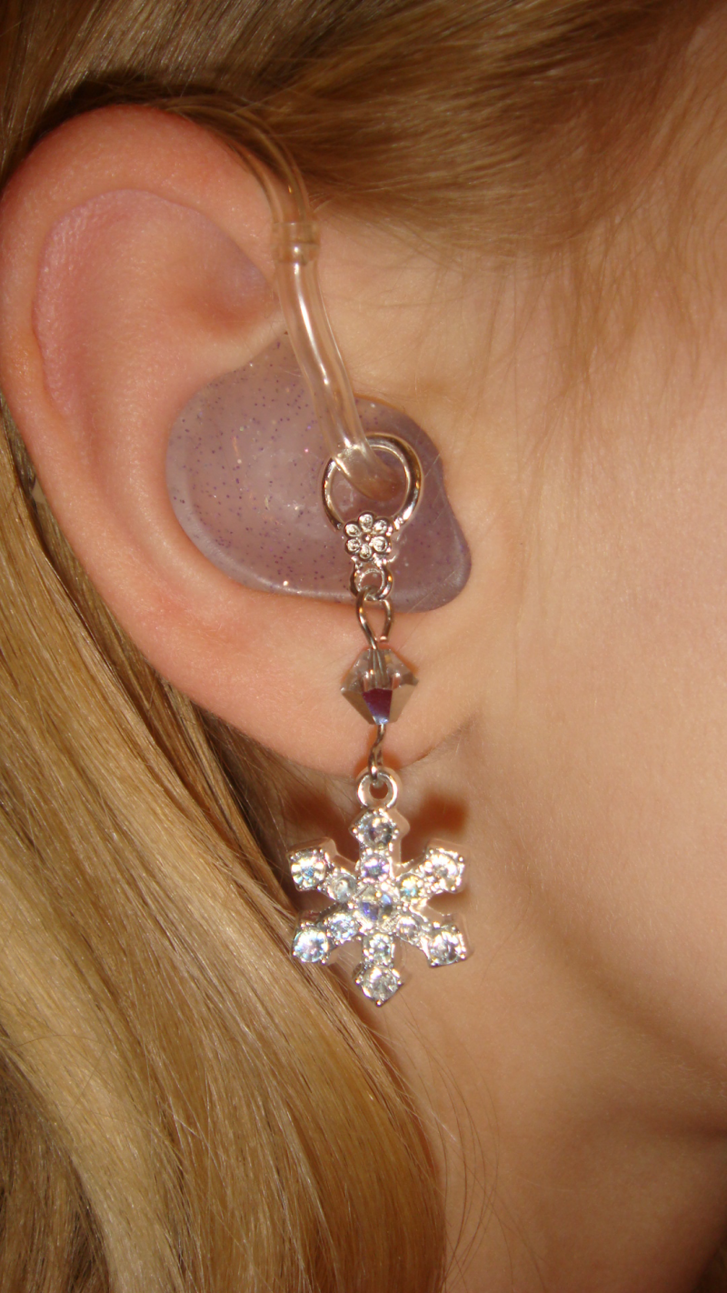 hearing aid earmold with fun, jeweled charm