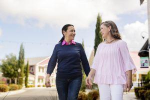 Two women walking outside.