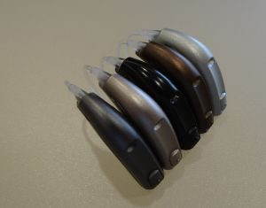 Hearing aids lined up in a row