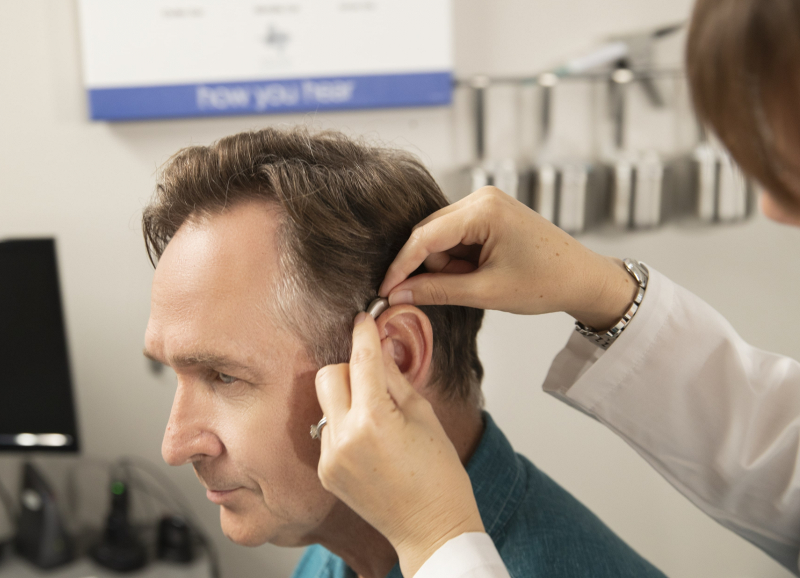 A man tries out hearing aids