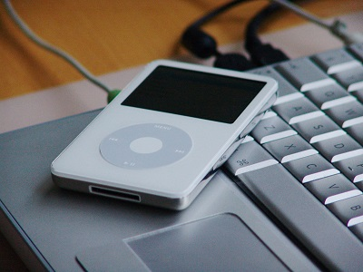 iPod and laptop keyboard pictured to demonstrate two devices that can connect to bluetooth hearing aids.