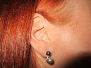 Close up of discreet hearing aid in someone's ear