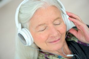 A woman listens to music.