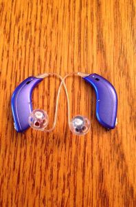 Two different colors of BTE hearing aids