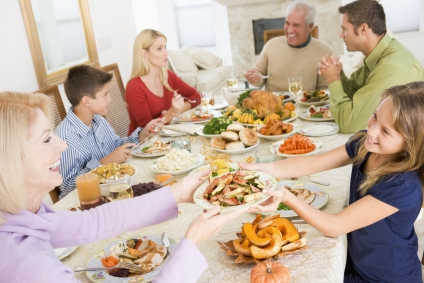 Large family passing food around the table.