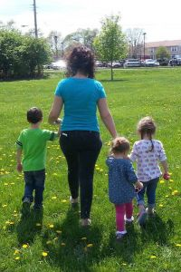 kids walking with mom