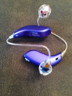 two purple hearing aids