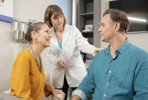 A man discusses hearing loss with his audiologist