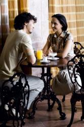 Couple Enjoying Conversation in Café