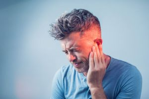 A man experiences a spike in tinnitus intensity.