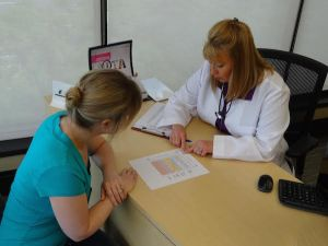 hearing care practitioner reviewing audiogram with patient