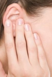 woman's ear with hand held over it, ear pain