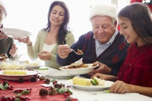 multigenerational family enjoying holiday dinner together